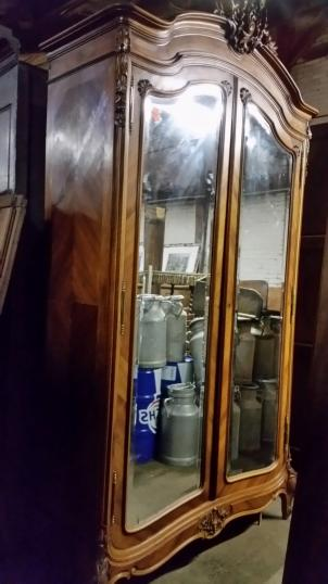 101-92 - A Walnut Armoire with Mirrored Doors
