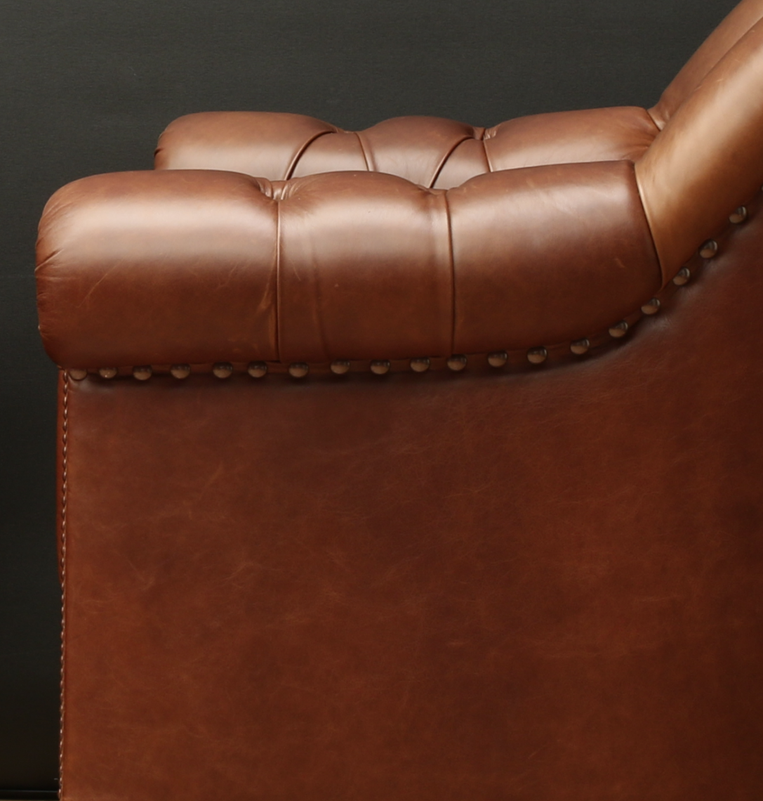 Deep Buttoned Leather Armchairs