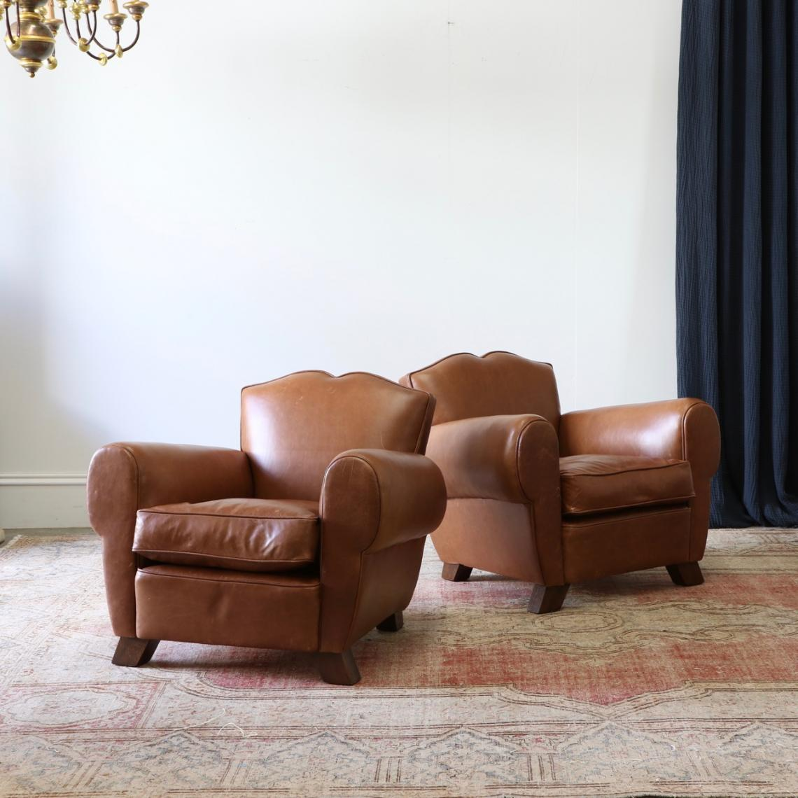116-84 - Pair of Leather Armchairs